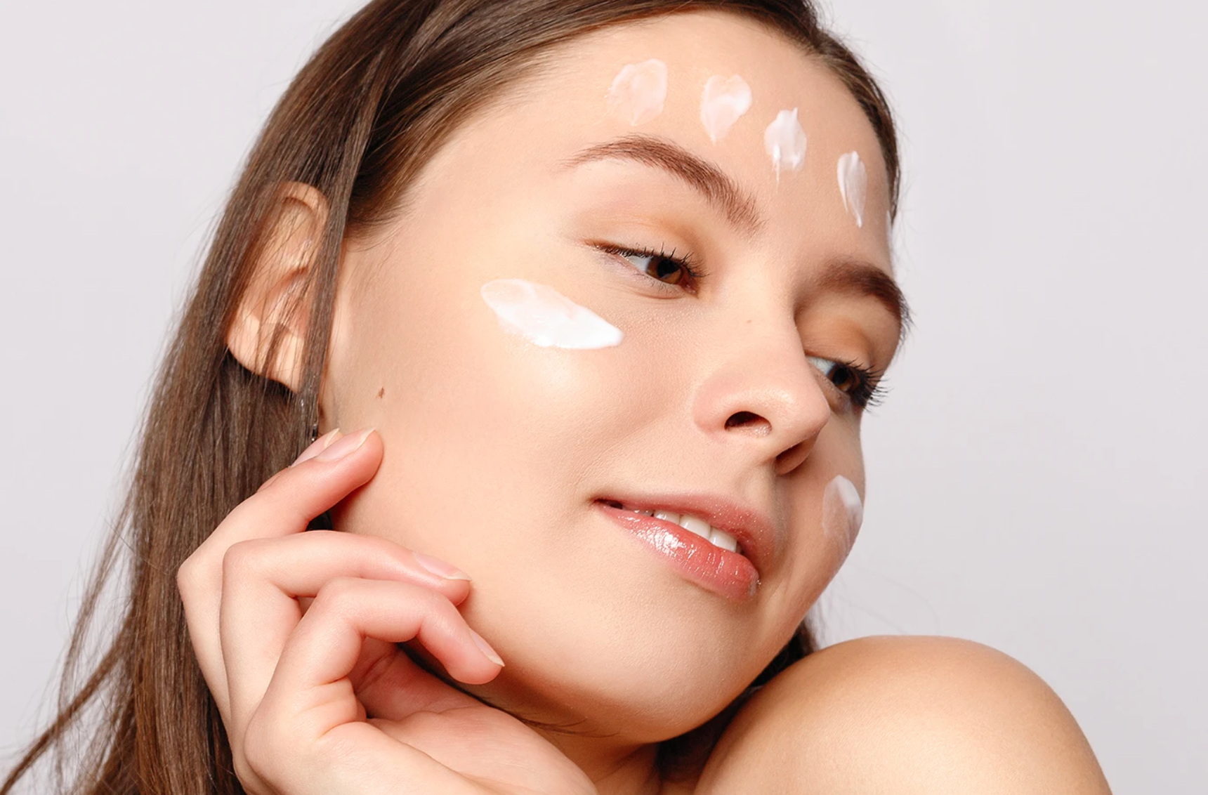woman with skincare textures on face